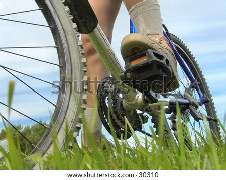 Low angle view of bike and feet.
