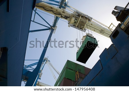 Low angle view of dockside crane against the sky Limassol Cyprus - stock photo