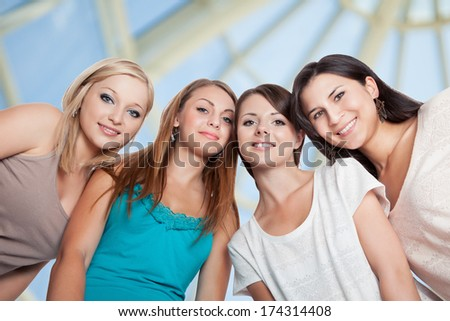 Low Angle View Of Female Friends Smiling - stock photo