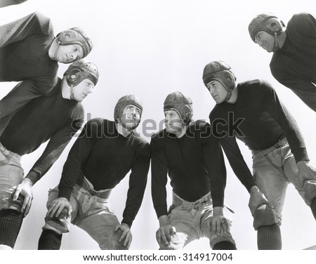 Low angle view of football huddle - stock photo
