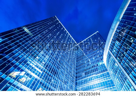 low angle view of illuminated modern building exterior - stock photo