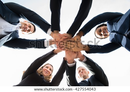 Low Angle View Of Multi-racial Businesspeople Stacking Hands Over Each Other