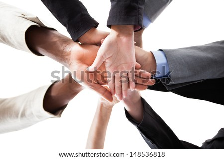 Low Angle View Of Multiracial People Stacking Hands Over Each Other
