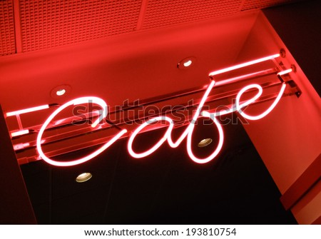 Low angle view of neon sign of a cafe - stock photo