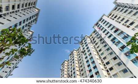 Low angle view public housing hdb stock photo royalty free low angle view of public housing hdb resident buildings flats complex with trees and sun solutioingenieria Images