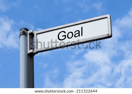 Low angle view of signpost with Goal sign against sky - stock photo