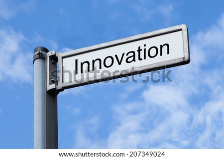 Low angle view of signpost with Innovation sign against sky - stock photo
