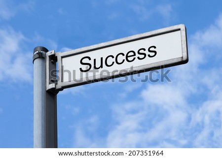 Low angle view of signpost with Success sign against sky - stock photo