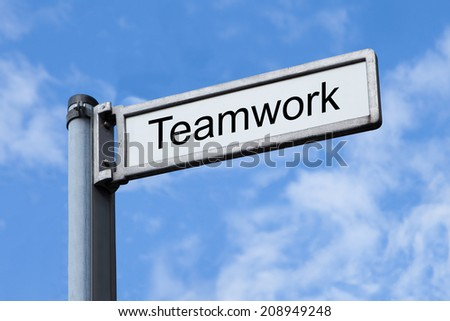 Low angle view of signpost with Teamwork sign against sky - stock photo