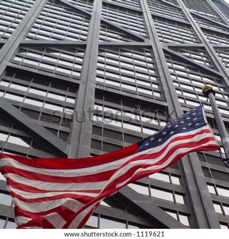 Low angle view of the American flag outside John Hancock Building in Chicago - stock photo