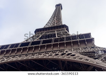 Low angle view of the Eiffel Tower, Paris, France looking up to the top as it disappears into the mist