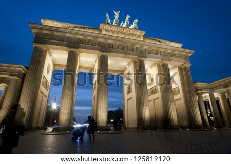 Low angle view of the historical Brandenburg Gate, or Brandenburger Tor, Berlin, Germany illuminated at night - stock photo