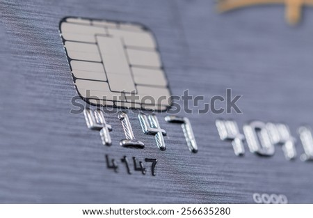 Low angle view of the microchip and raised numbers on a bank card  - stock photo