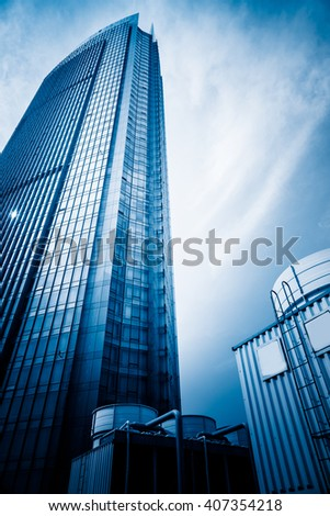 low angle view of the modern skyscraper,blue toned image. - stock photo