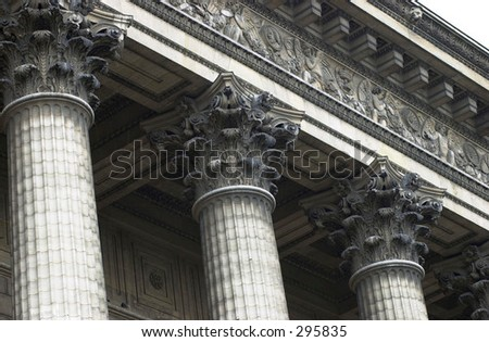 Low angle view of the top of ornate columns outside a building, Paris, France,