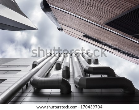 Low angle view of three skyscrapers ventilation pipes. Brick wall, venting pipeline or air duct. Tallinn, Estonia