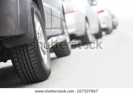 Low angle view of tire of car in traffic jam