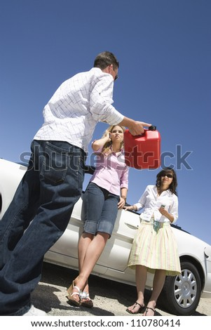 Low angle view of travelers waiting for someone to help them - stock photo