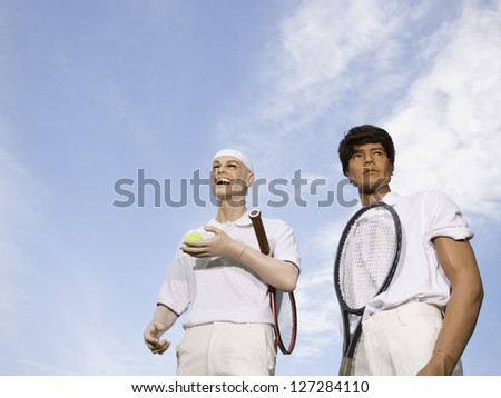 Low angle view of two mannequins portraying tennis players