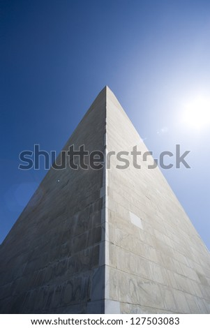 Low angle view of Washington Monument against sun