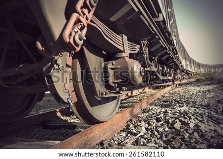 Low angle view of wheel of vintage train - stock photo