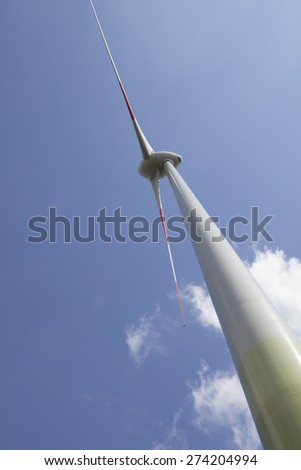 Low angle view of wind turbine against sky - stock photo