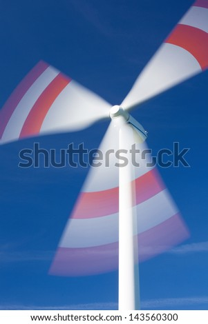 Low angle view of wind turbine in motion against sky - stock photo