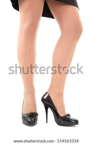 Low-angle view of woman in black high heels