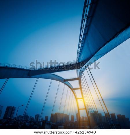 low angle view yangtse river bridge structure,chongqing china,blue toned image. - stock photo
