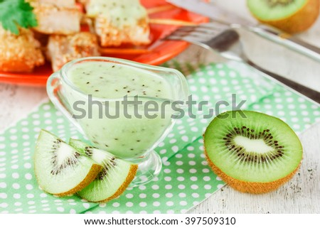 Low-calorie sauce of kiwi to the fish and meat, selective focus - stock photo