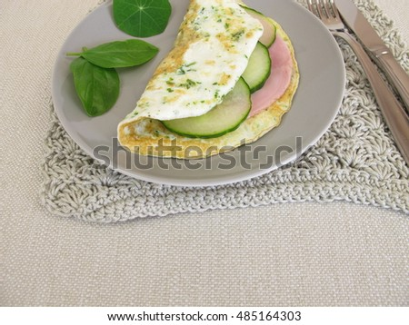 Low carb egg white omelet with ham and cucumber
