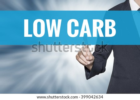 Low Carb word on virtual screen touch by business woman cyan sky tab - stock photo
