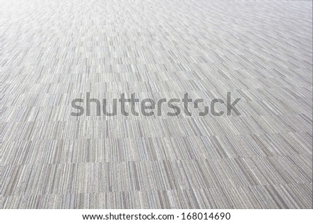 Low close up view of a beige furry carpet texture background,  - stock photo
