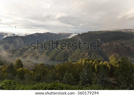 Low cloud moving across the Geres valley in northern Portugal - stock photo