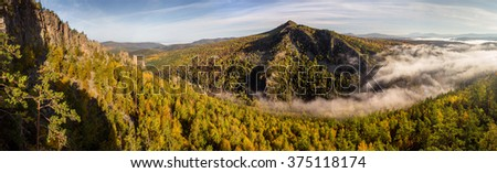 Low clouds over the mountains - stock photo