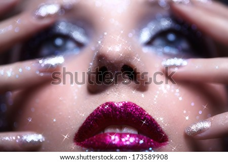 Low depth of focus portrait of beautiful young woman with vogue shining sparkle face makeup  - stock photo