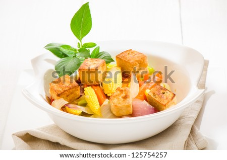 low fat healthy Vegetarian food with fried tofu in white bowl on white table