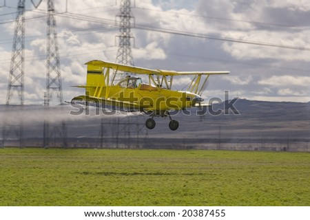 Low flying crop spraying aircraft - stock photo