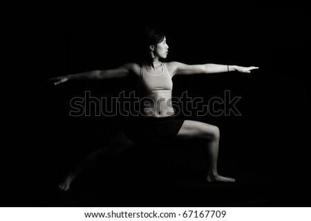 Low Key Fitness woman on black - stock photo