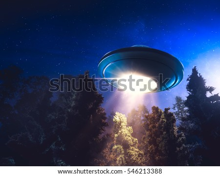 low key image of UFO hovering over a forest at night