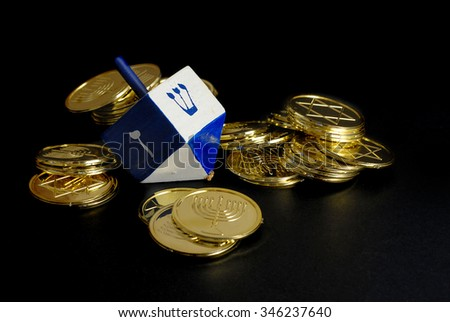 Low Key Image With Dramatic Side Lighting Of Hanukkah Dreidel And Gelt Objects Are On