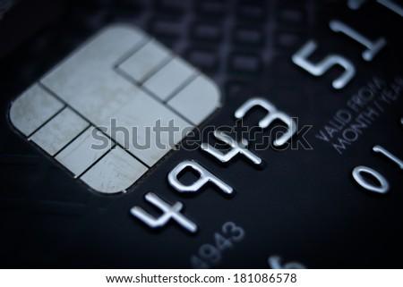 Low key macro shot close-up of credit card. - stock photo