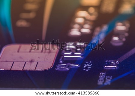 Low key macro shot with old credit card. - stock photo