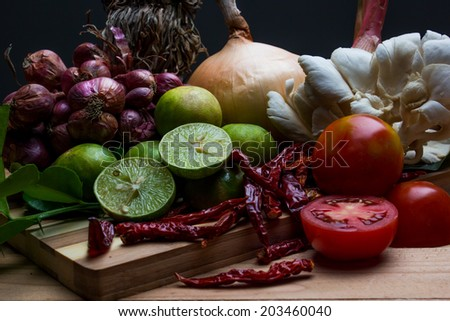 Low key of Ingredients of Thai spicy food, tom yum. - stock photo