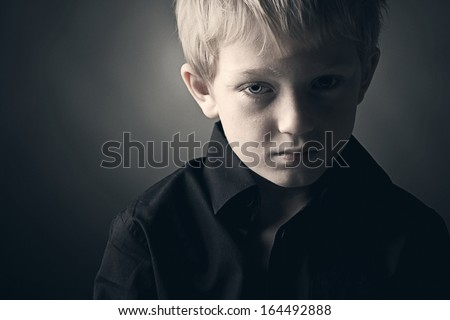 Low Key Photo of Sad Boy - stock photo
