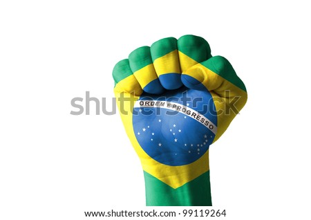 Low key picture of a fist painted in colors of brazil flag - stock photo