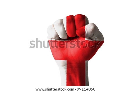 Low key picture of a fist painted in colors of england flag - stock photo