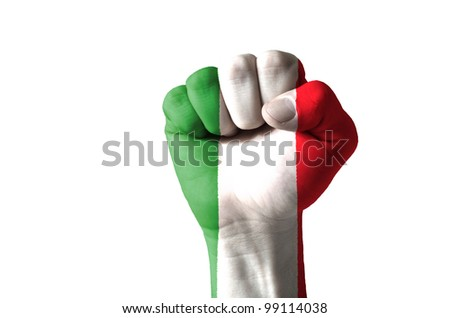 Low key picture of a fist painted in colors of italy flag - stock photo