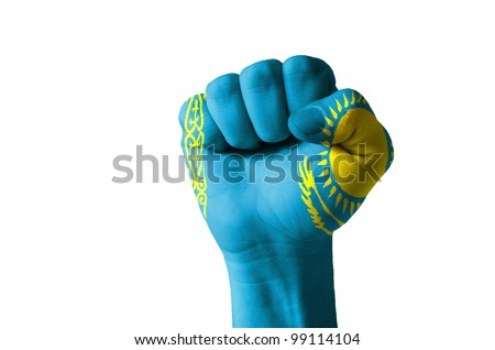Low key picture of a fist painted in colors of kazakhstan flag - stock photo