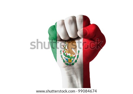 Low key picture of a fist painted in colors of mexico flag - stock photo